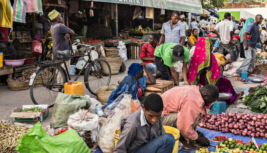 STONE TOWN, TANZANIA - January 2018 Overcrowded local fruit and vegetable market with lots of sellers and buyers in Stone town, Zanzibar, Tanzania