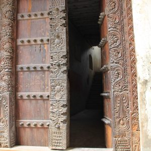 Opened entrance door in Stone town, Island Zanzibar, Tanzania, East Africa, Africa